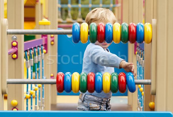 мало мальчика играет счеты кольцами Сток-фото © d13