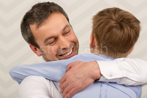Father giving hugs to dear son Stock photo © d13
