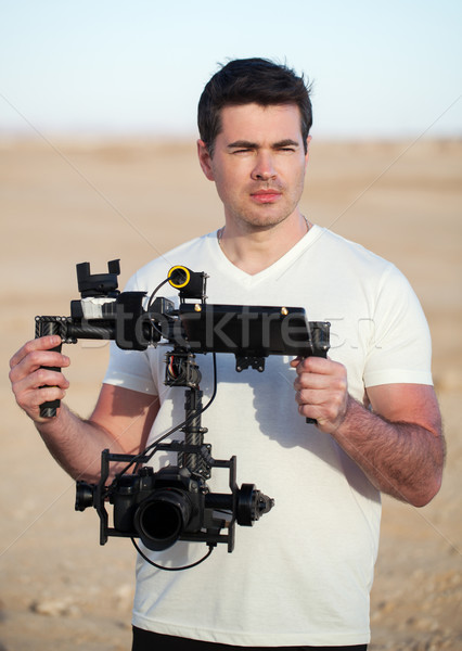 Videographer with steadicam equipment on the beach Stock photo © d13