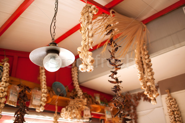 Garlic and Peppers Hanging from Ceiling In Market Stock photo © d13
