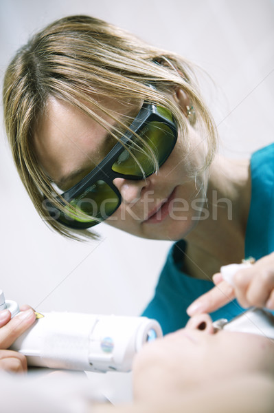 Doctor doing a fractional skin laser treatment Stock photo © d13