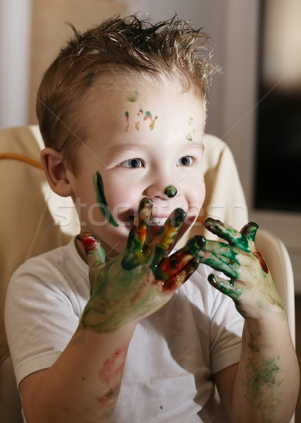 Excited little boy playing with finger paints Stock photo © d13