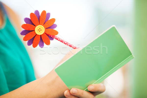 Woman Writing in Notebook with Flower Pencil Stock photo © d13