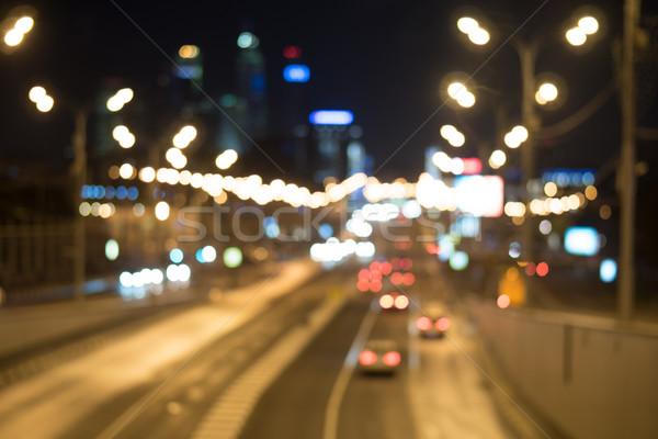 Stock photo: Blurred lights of city traffic at night
