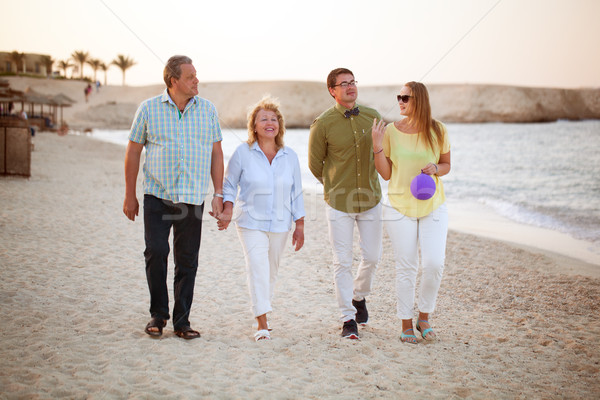 Young and senior couples walking along the coast Stock photo © d13