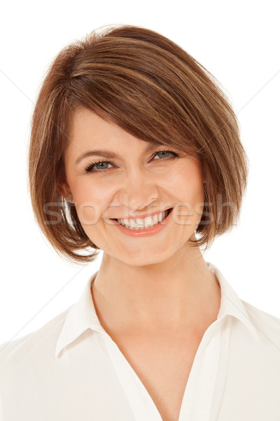 Cheerful adult woman smiling at camera Stock photo © d13