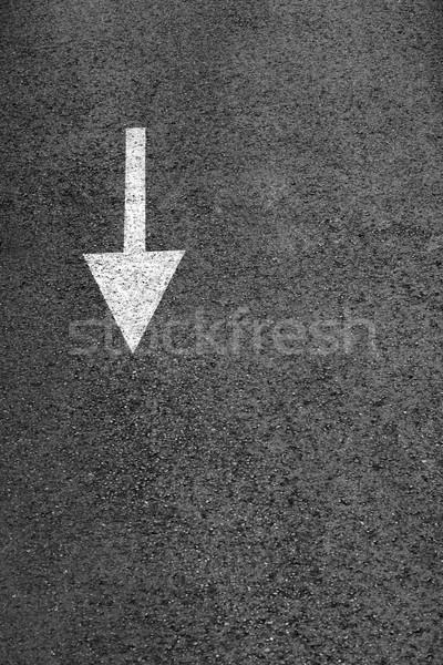 White arrow on the dark gray asphalt. Stock photo © d13
