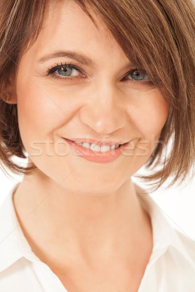 Studio shot of beautiful adult woman smiling at camera Stock photo © d13