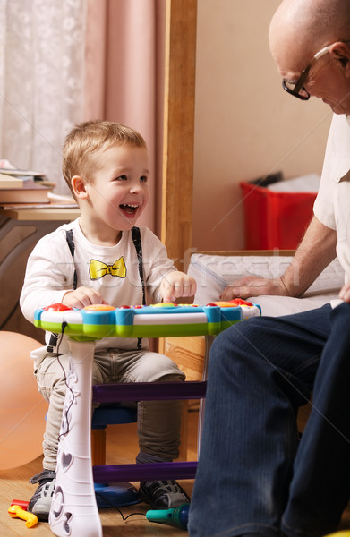 Candid portrait of a beautiful laughing toddler Stock photo © d13