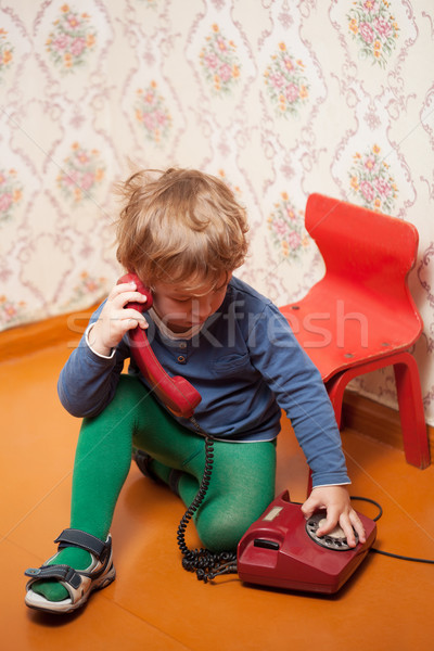 Young boy using red phone Stock photo © d13