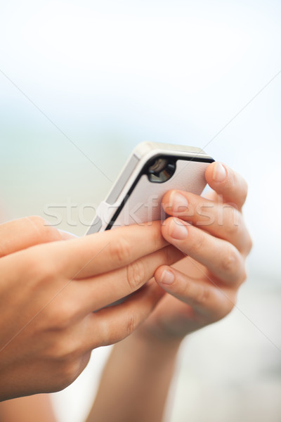 Child checking a text message on a mobile Stock photo © d13