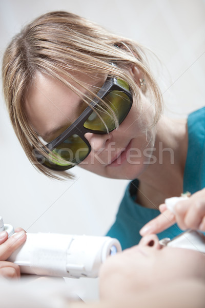 Laser facial treatment in cosmetology clinic Stock photo © d13