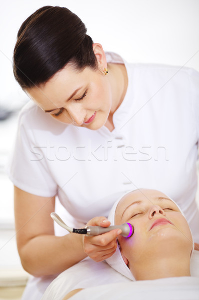 Cosmetician providing lifting procedure with special equipment Stock photo © d13