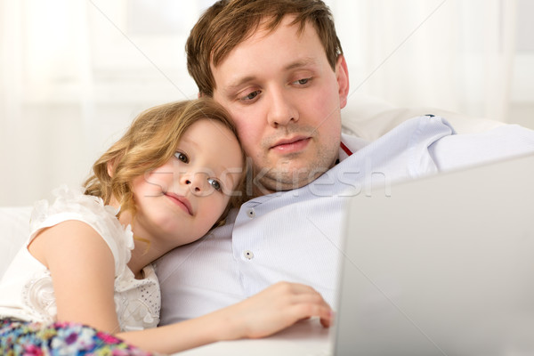 Father and little daughter using laptop Stock photo © d13