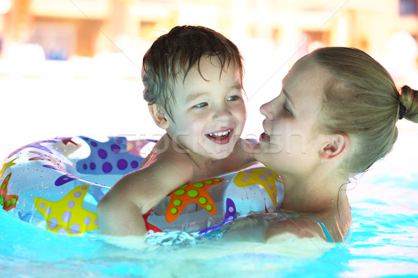 Mother and her son in the outdoor swimming pool Stock photo © d13
