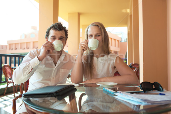 Young couple drinking coffee on a balcony Stock photo © d13