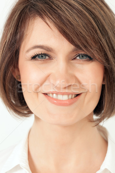 Headshot of adult woman with toothy smile. Stock photo © d13