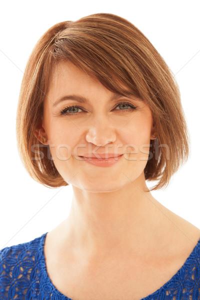 привлекательный взрослый женщину глядя камеры улыбаясь Сток-фото © d13