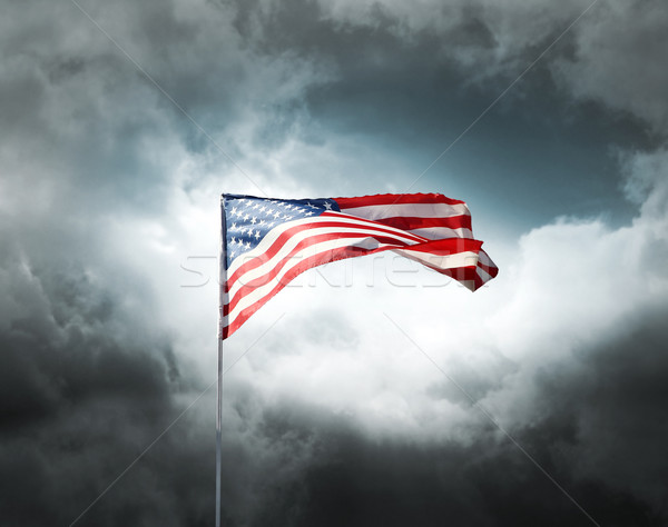 American flag on a cloudy dramatic sky Stock photo © daboost