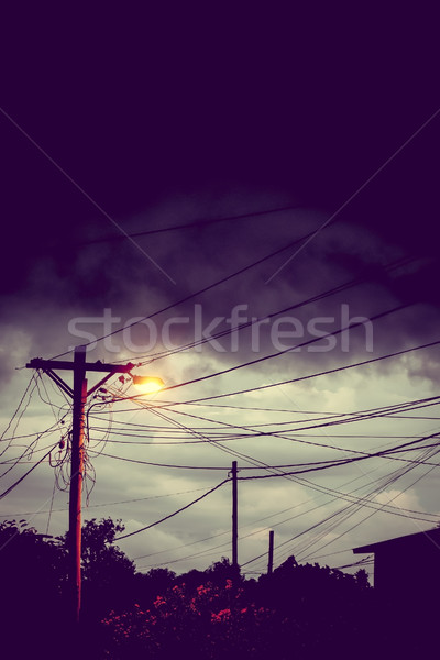Street light at night with a stormy sky background Stock photo © daboost
