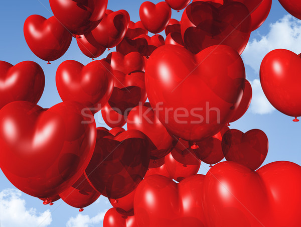 red heart shaped balloons floating in the sky Stock photo © daboost