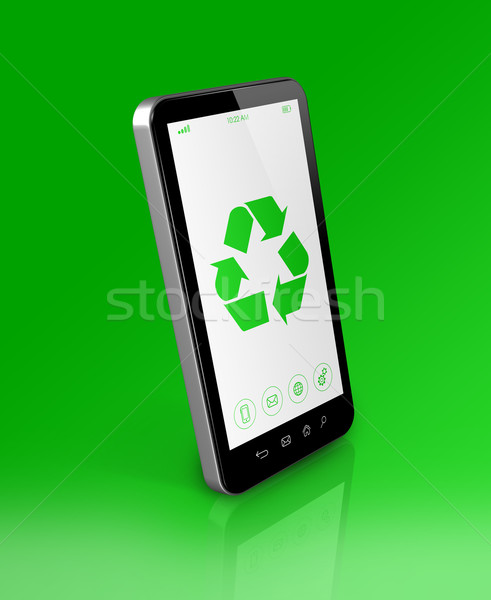 Smartphone with a recycling symbol on screen. ecological concept Stock photo © daboost