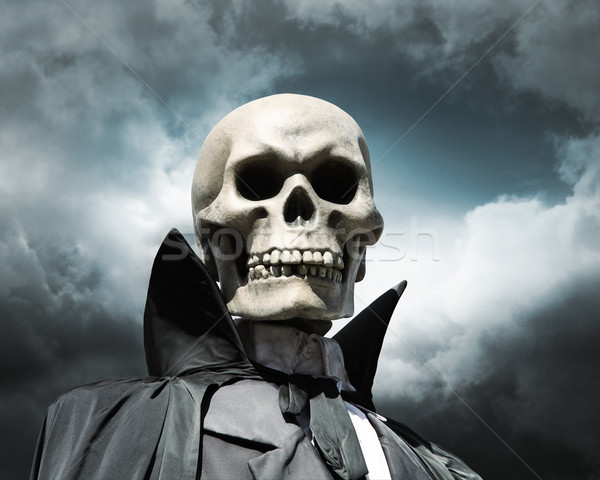 grim reaper. death's skeleton on a cloudy dramatic sky Stock photo © daboost