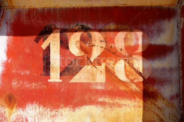 old rusty painted metal wall with numbers Stock photo © daboost