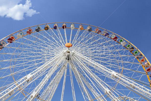 Ferris wheel in an amusement park Stock photo © daboost