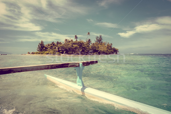 Pirogue on the way to paradise tropical atoll in Moorea Island l Stock photo © daboost