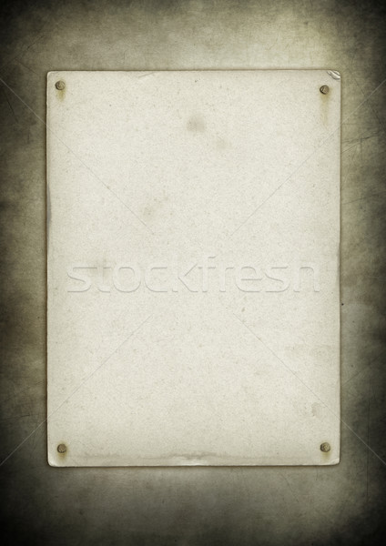 Blank old poster nailed on a grunge wall Stock photo © daboost