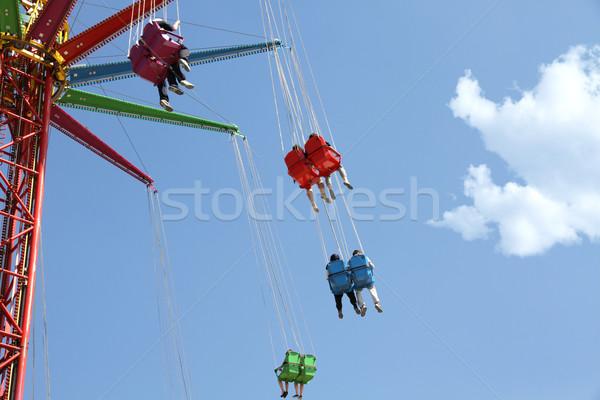 Carousel in an amusement park Stock photo © daboost