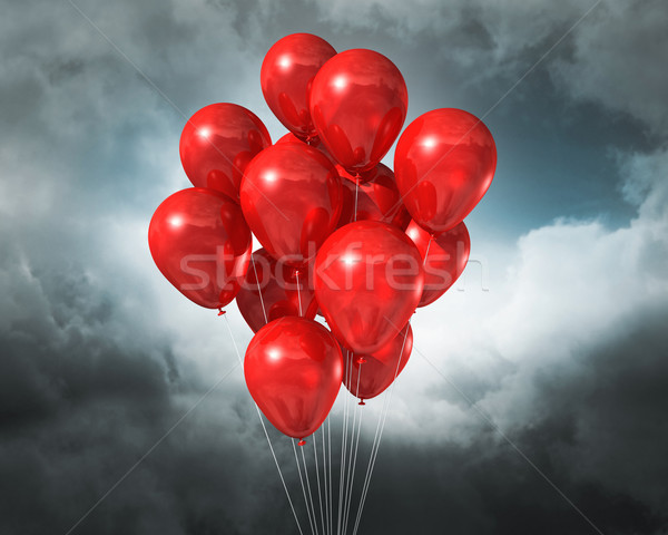 red balloons on a cloudy dramatic sky Stock photo © daboost