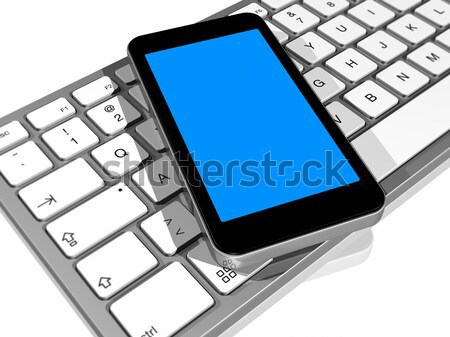 mobile phone on a computer keyboard Stock photo © daboost