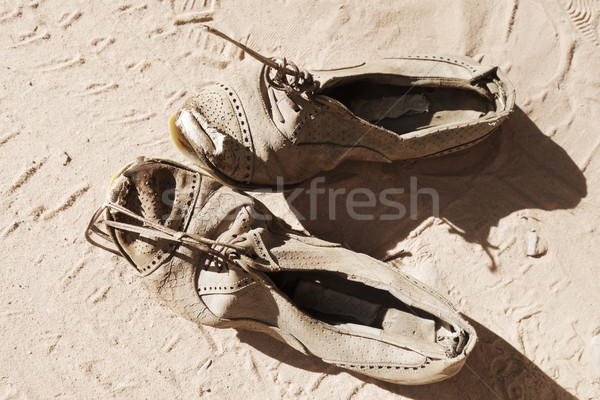 Eski çift ayakkabı kum kirli moda Stok fotoğraf © daboost