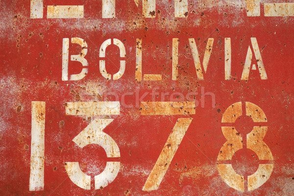 old rusty painted metal wall with inscriptions Stock photo © daboost