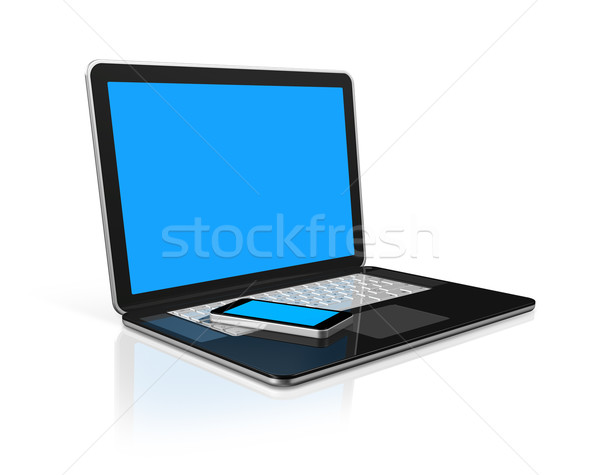 Mobile phone on a laptop Stock photo © daboost