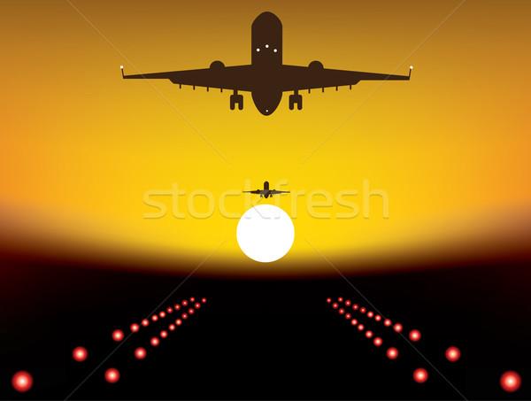 Leszállás repülőgép kifutópálya naplemente nap fekete Stock fotó © Dahlia