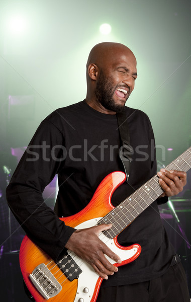 Bassist performing ons stage. Stock photo © danienel