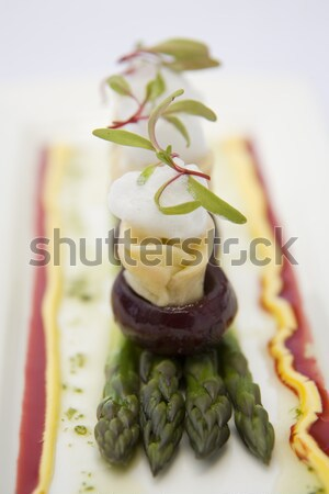 Delicious goats cheese on cooked baby beetroot. Stock photo © danienel