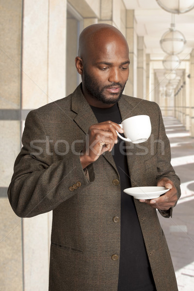 Man having coffee outside office building. Stock photo © danienel