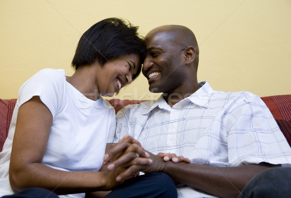 Happy couple on couch Stock photo © danienel