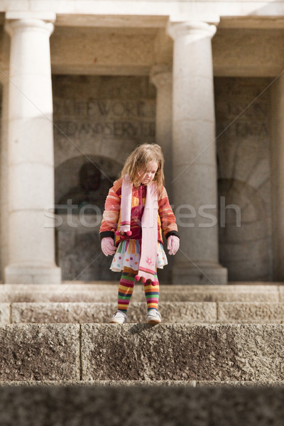 Funky little girl on big steps Stock photo © danienel