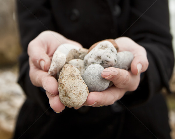 Woman holding pebbles Stock photo © danienel