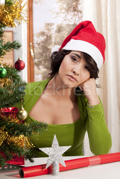 Young woman having a lonely Xmas. Stock photo © danienel