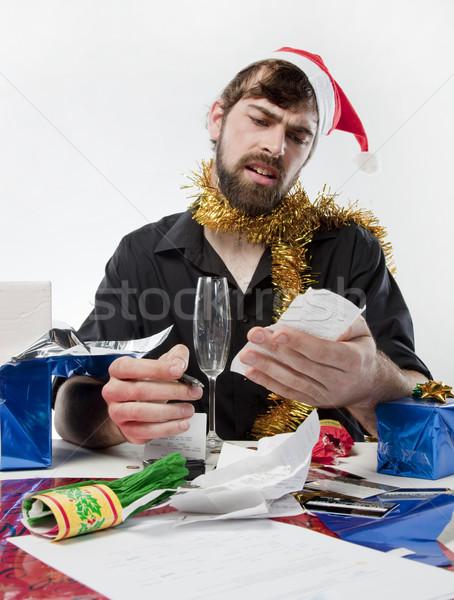 Karácsony pénzügyek férfi mikulás kalap lehangolt Stock fotó © danienel