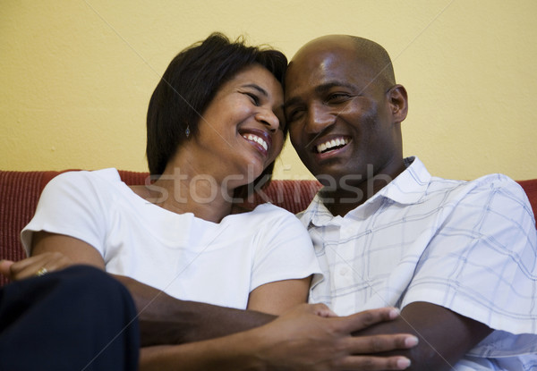 Happy couple on couch Stock photo © danienel