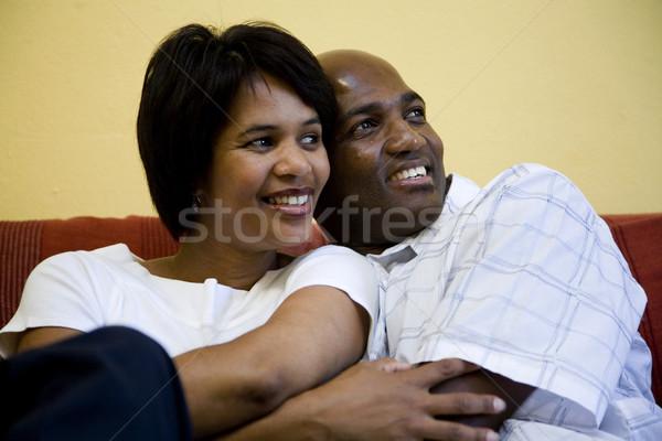 Heureux couple canapé séance souriant africaine Photo stock © danienel