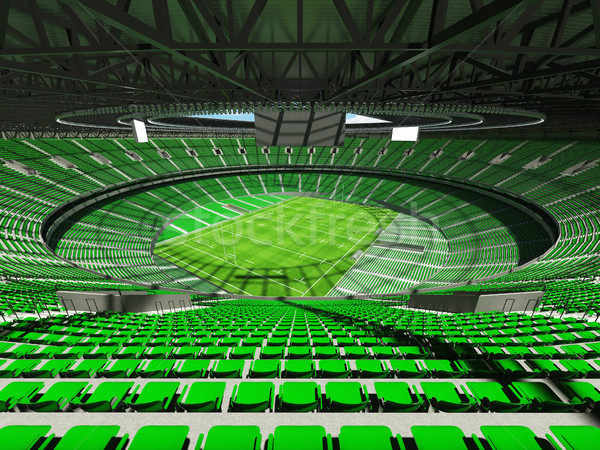 3D render of a round rugby stadium with  green seats and VIP box Stock photo © danilo_vuletic