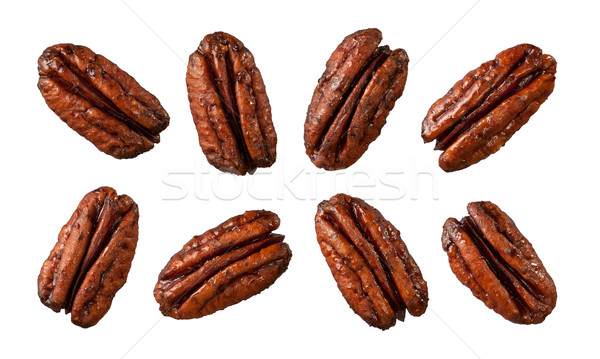 Caramelized Pecans isolated on white Stock photo © danny_smythe